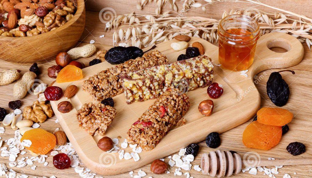 fitness bars granola oatmeal nuts dried fruit honey table 62798760